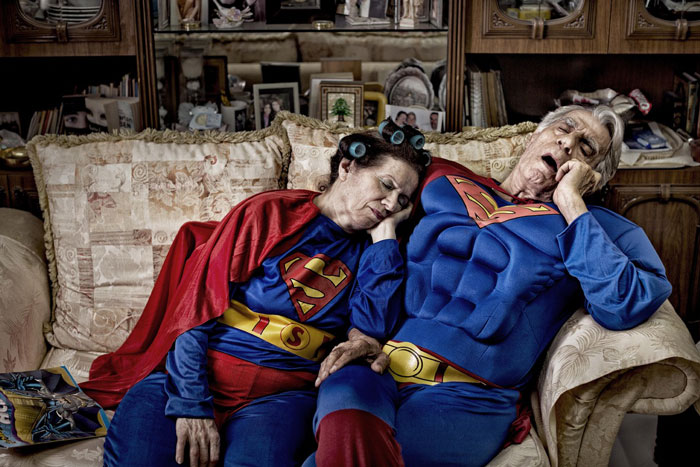 Superman and Supergirl, tired and sleeping