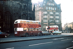 PD2s 702 turning into Lothian Rd on a service 9, while 570 is on a 10 waiting at the lights at the West End of Princes St....