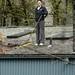 rooftop rachel, sweeping leaves    MG 2740