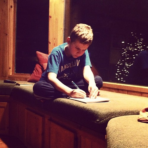 An 8:00 bedtime doesn't always work for Graham, what with him being ALMOST NINE. He's allowed to stay up if he reads or writes. Tonight, he's writing.