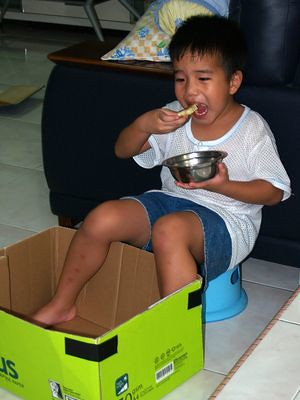 Julian eating in a box
