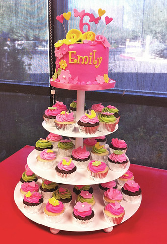 pink green and yellow 6th birthday cupcake tower with flowers and hearts tower display