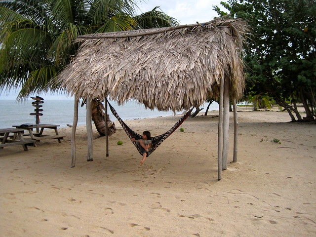 kid swinging in hammock belize