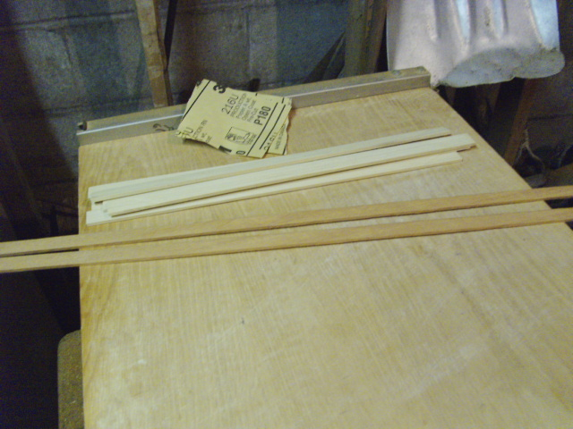 Cut and sanded Strips of Mahogany and Poplar