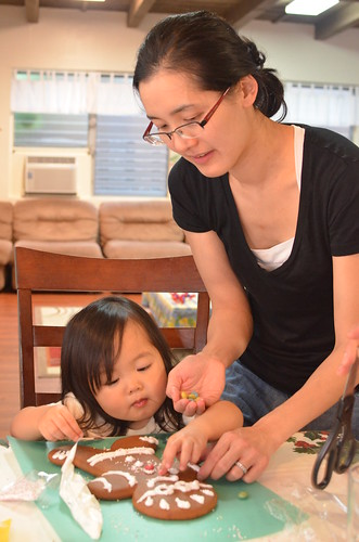 Aunty Thida helping Maia with Gingerbread man