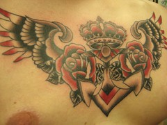Winged Rose Chest Tattoo