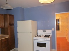 kitchen wall w/door to dining room before