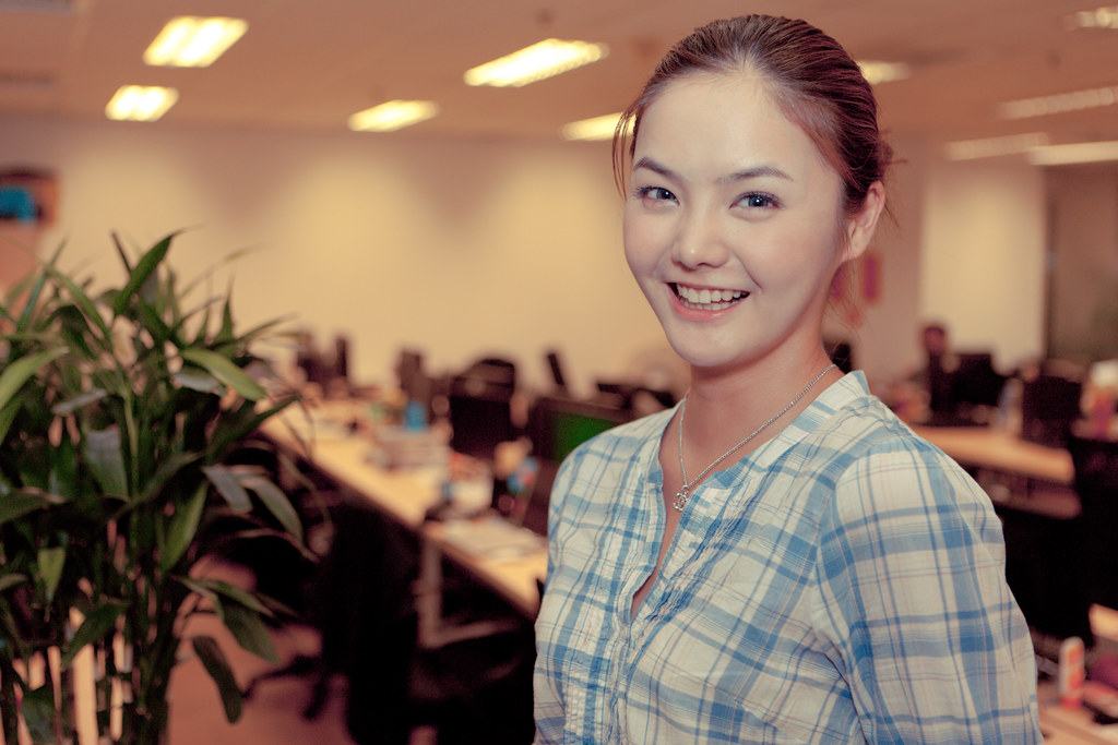 Lovely office worker with a bright smile.