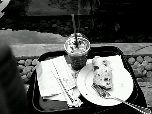 Eating my meal on the floor. Outside starbucks.  Saw a posted tip at foursquare and ut says that there are eight people seated but one person only drinks coffee. Hhahaa. I agree. by popazrael