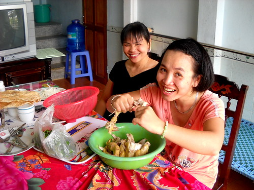 Trang and Hoa Pickin' Chicken