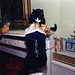 Photograph of Socks the Cat Peeking into his Christmas Stocking: 12/21/1993