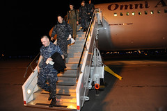 NAVAL AIR FACILITY MISAWA, Japan (Dec. 1, 2011) Sailors attached to Patrol Squadron (VP) 1 disembark from an aircraft after arriving here for a deployment. (U.S. Navy photo by Mass Communication Specialist 1st Class Matthew M. Bradley)