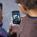 Child looks at Parade Footage on iPhone by David Hilowitz