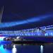 Media City footbridge at night by jonnywalker