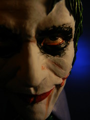 costume(0.0), joker(1.0), face(1.0), head(1.0), fictional character(1.0), close-up(1.0), darkness(1.0),