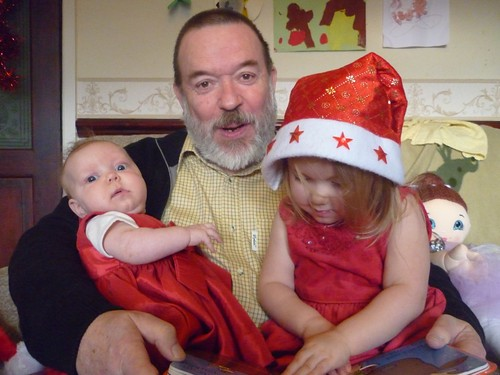 Ellie reading to Phoebe and Grandad