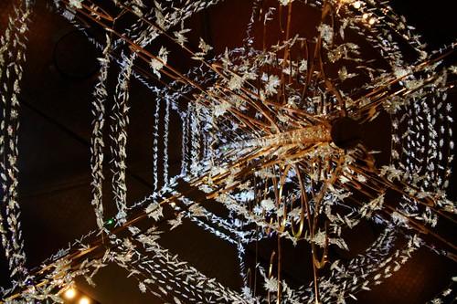 Under the chandelier
