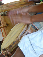 string instrument(0.0), hand(1.0), art(1.0), wood(1.0), barrel drum(1.0), drum(1.0), hand drum(1.0), skin-head percussion instrument(1.0),