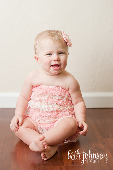 baby girl in pink romper photography studio tallahassee