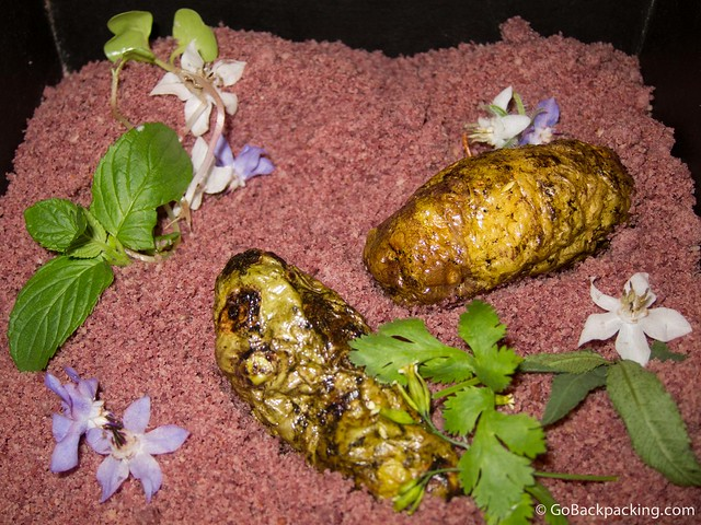 Tubers in a bed of shredded almonds