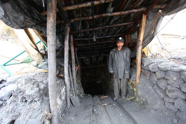 Coal miner standing in this adit, near Muzaffarabad, AJK, Kashmir