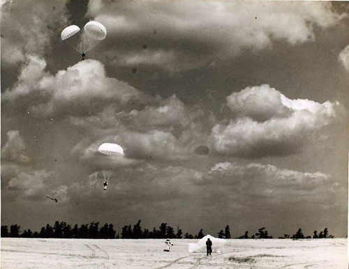 Parachutes landing, location unknown NHHS Photo