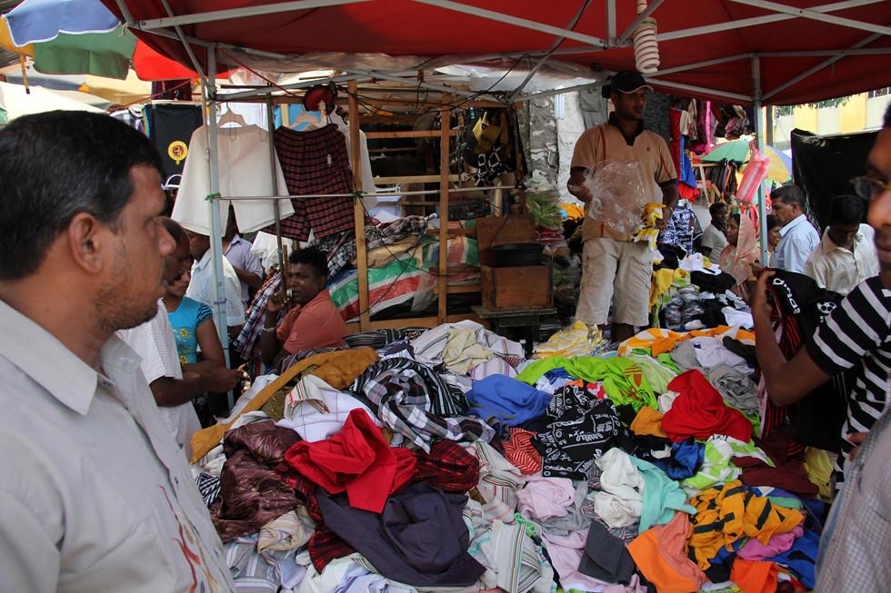 Selling Clothes at Pettah Market, Colombo, Sri Lanka