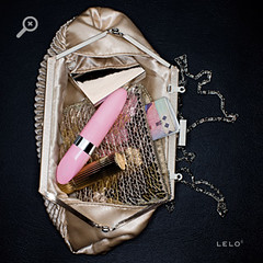 Pink Lelo vibe in a purse. It looks like a tube of lipstick