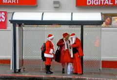 Bus Stop Santas. San Francisco (by: Lynn Friedman, creative commons)