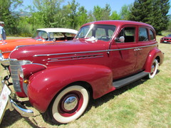 1941 ford(0.0), plymouth deluxe(0.0), automobile(1.0), automotive exterior(1.0), vehicle(1.0), mid-size car(1.0), hot rod(1.0), antique car(1.0), sedan(1.0), vintage car(1.0), land vehicle(1.0), luxury vehicle(1.0), motor vehicle(1.0),