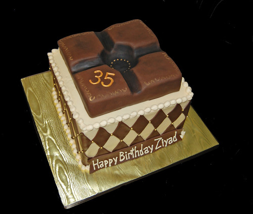 35th birthday cream brown and gold cigar themed cake