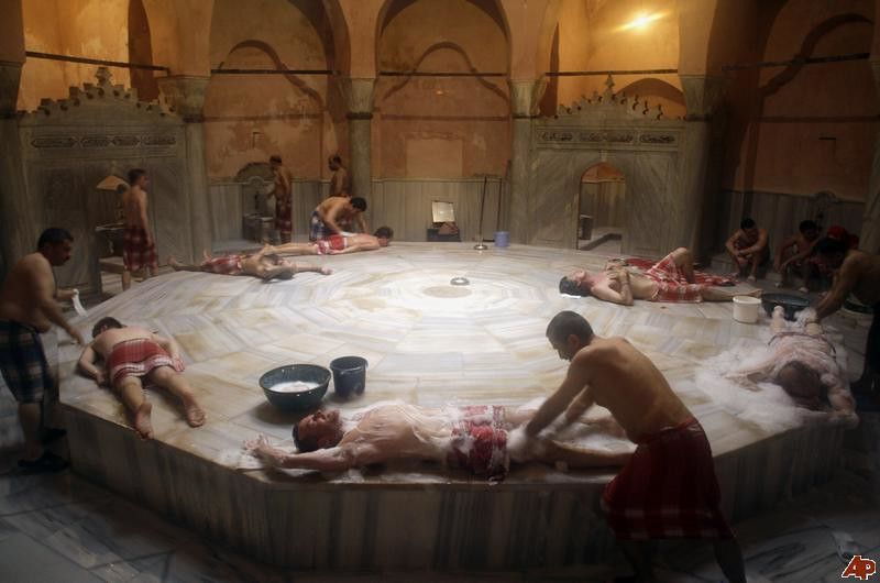 Guests at an Istanbul hamam getting scrubs and foam washes