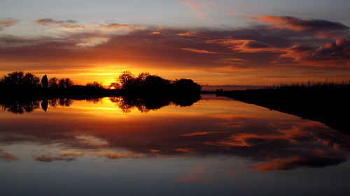 sunset red sky orange water silhouette clouds reflections mirror canal amazing image stunning thorne stainforth keadby