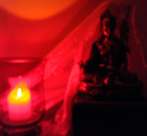 Abstract: Candle offering to Padmasambhava, statue, katag, box, Seattle, Washington, USA by Wonderlane