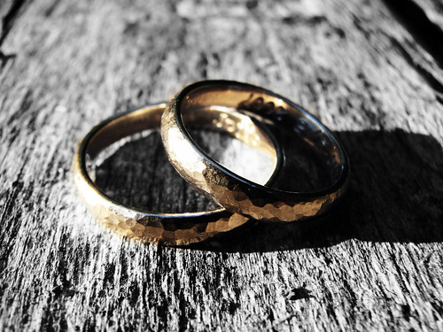 Two rings on a wooden surface