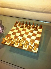 english draughts(0.0), recreation(0.0), chessboard(1.0), indoor games and sports(1.0), yellow(1.0), sports(1.0), tabletop game(1.0), games(1.0), chess(1.0), lighting(1.0), board game(1.0),