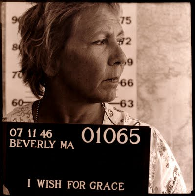 Black and white mugshot-style photo of a middle-aged white woman. Text reads I wish for grace