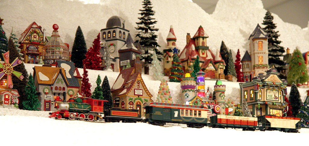 a train passing on christmas village mountain miniature electric train exhibits at the nixon presidential - Miniature Christmas Village