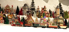 A train passing on Christmas Village mountain. Miniature Electric Train Exhibits at the Nixon Presidential Library