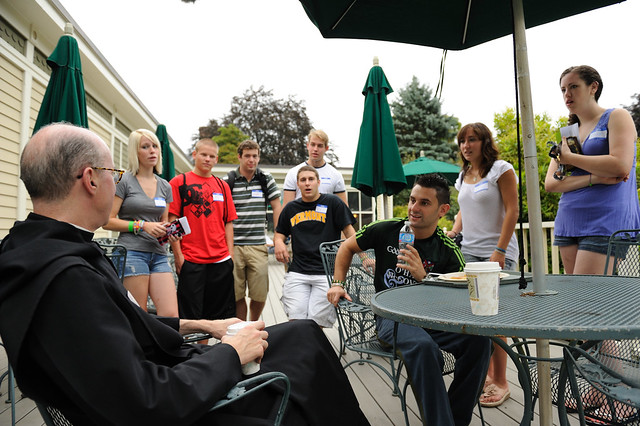 Fr. Augustine Kelly, O.S.B. greets students on move in day 2011