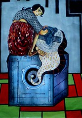 a painting of a woman on top of a washing machine