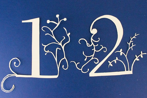 Completed papercut table numbers