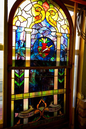 A stained glass window crafted and donated by a founding Joyce to one of the first churches in Laramie.