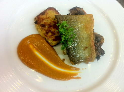 Pan-Seared Artic Char with grilled radicchio di Treviso, pancetta chickpea cake and sauce romesco