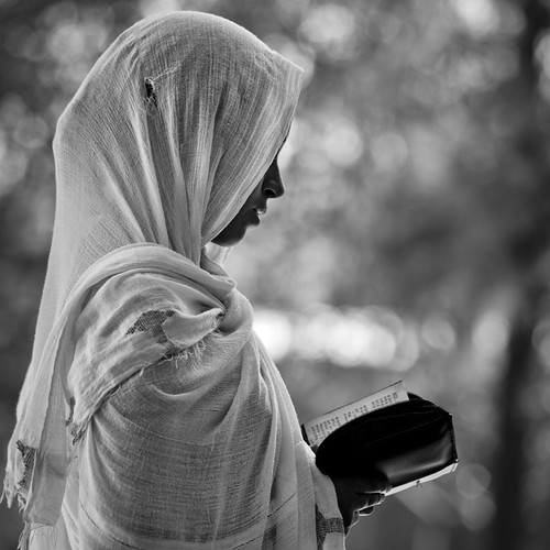 Woman reading bible in church - Ethiopia