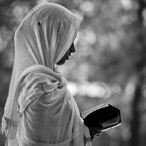 Woman reading bible in church - Ethiopia
