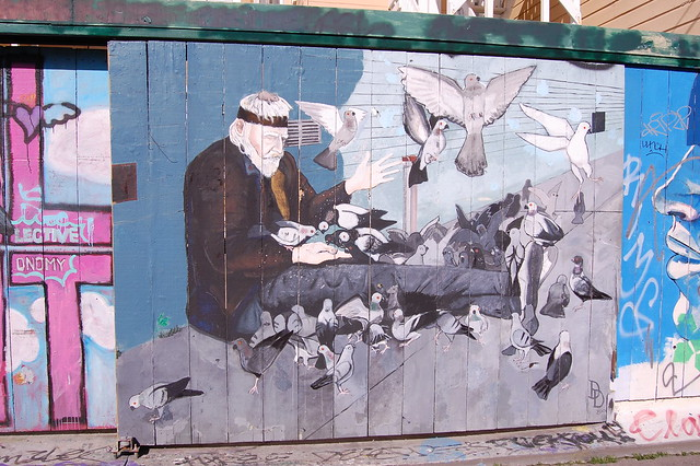 Lonestar Swan feeding the pigeons - Clarion Alley Mural by Daniel Doherty
