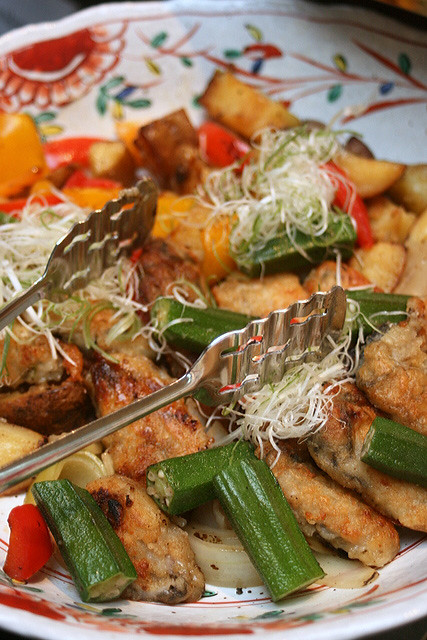 Oysters in batter, sauteed with vegetables