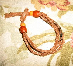 hand(0.0), chain(0.0), rope(0.0), necklace(0.0), organ(0.0), art(1.0), orange(1.0), knot(1.0), bracelet(1.0),