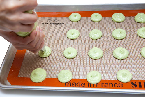 Me, piping macarons (pistachio)